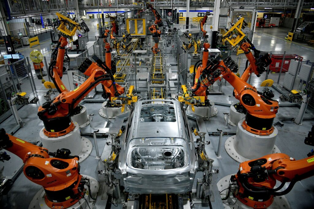 FILE PHOTO: Autonomous robots assemble an X model SUV at the BMW manufacturing facility in Greer, South Carolina, U.S. November 4, 2019.  REUTERS/Charles Mostoller/File Photo
