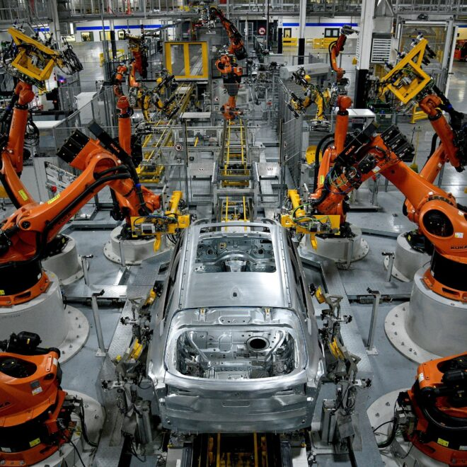 FILE PHOTO: Autonomous robots assemble an X model SUV at the BMW manufacturing facility in Greer